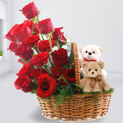 Delightful Arrangement of Twin Teddy with Red Roses