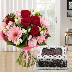 Mixed fresh Seasonal Flowers with festive Black Forest Cake