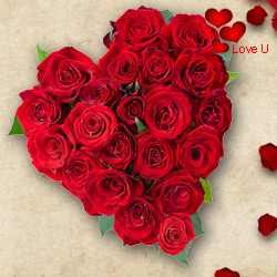 Exclusive <font color =#FF0000> Dutch Red </font>   Roses  in  Heart Shaped Arrangement