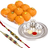 Pride-to-Possess Silver Plated Designer Tray with <font color=#FF0000>Haldiram</font> Ghee Ladoo & 2 Designer Rakhi and Roli Tilak Chawal