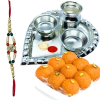 Trendy Rakhi and Silver Plated Paan Shaped Puja Thali