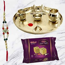 Soan Papri from <font color=#FF0000>Haldiram</font> and Stylish and Trendy looking Silver Plated Paan Shaped Puja Aarti Thali (weight 52 gms) along Rakhi, Roli Tilak and Chawal