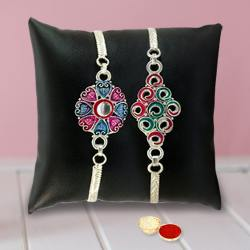 An Elegant Silver Plated Twin  Rakhi set with Roli Tilak and Chawal