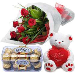 Buy Online Bouquet of Red Roses with I Love You Teddy N Ferrero Chocolates