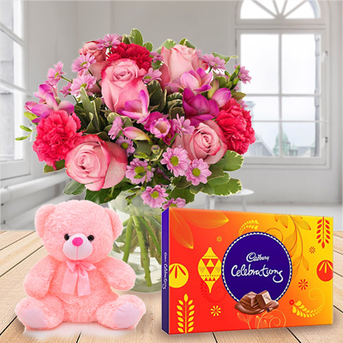 Online Gift of Mixed Flower in a Vase with Cadbury Celebration and Teddy