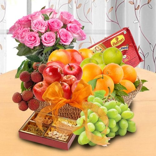 Mothers Day special basket of Fresh Fruits, Sweets and Pink Roses