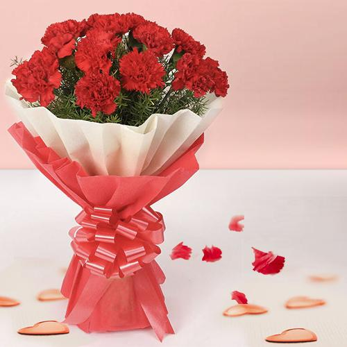 You can shop online for an elegant Hand Bouquet of Red Carnations in Tissue Wrapping