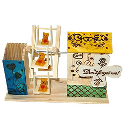 Extravagant Love Wooden Pen Stand with House and Wheel Swing