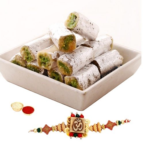 One or More Designer Ethnic Rakhi with 250 Gms. Kaju Pista Roll<br /><font color=#0000FF>Free Delivery in USA</font>